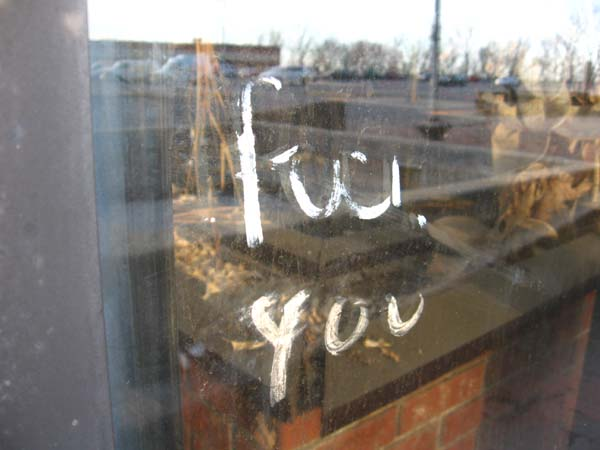 Even a parting sentiment painted on the window fades under the constant assault of time and the elements.