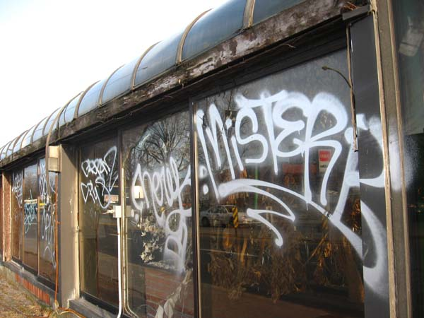 Graffiti, rotting wood, and stripped wiring.
