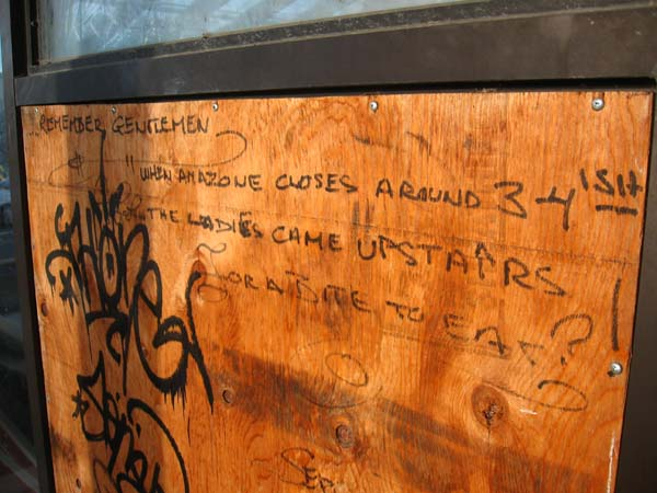 Graffiti on another board eulogises what someone once liked best about Picasso.