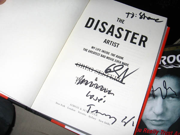 Intriguingly, Greg Sestero crossed out his own name before signing. Insanely, Tommy crossed out co-author Tom Bissell's name before signing.